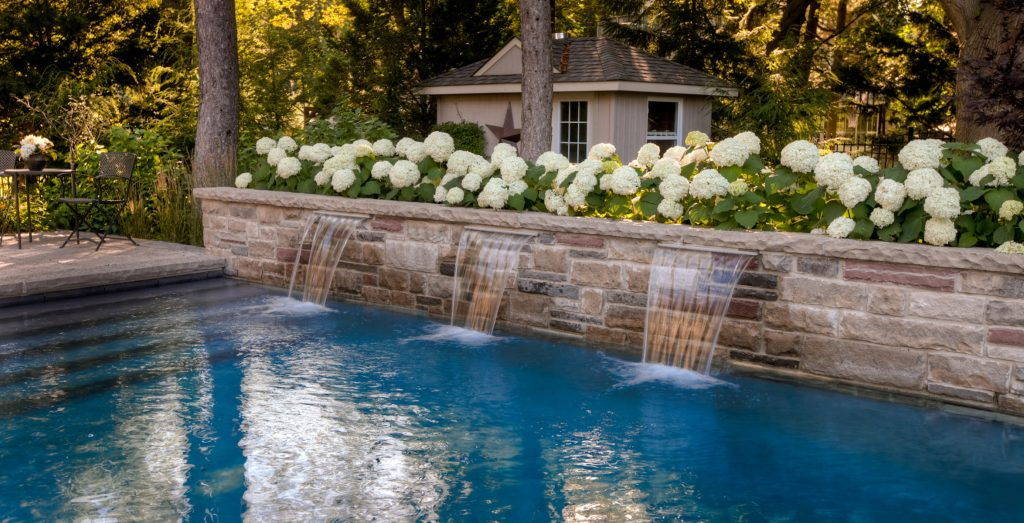 Water features you will want for your pool - Trasolini Pools Ltd