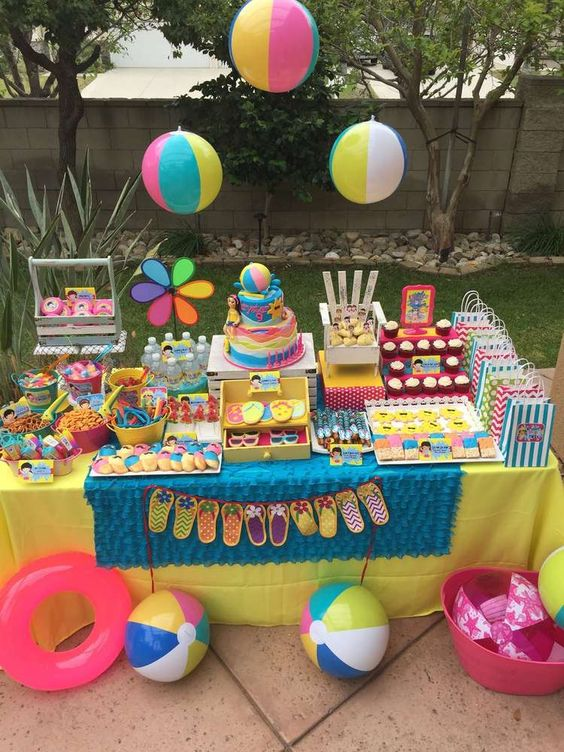 bright dessert table for birthday pool party