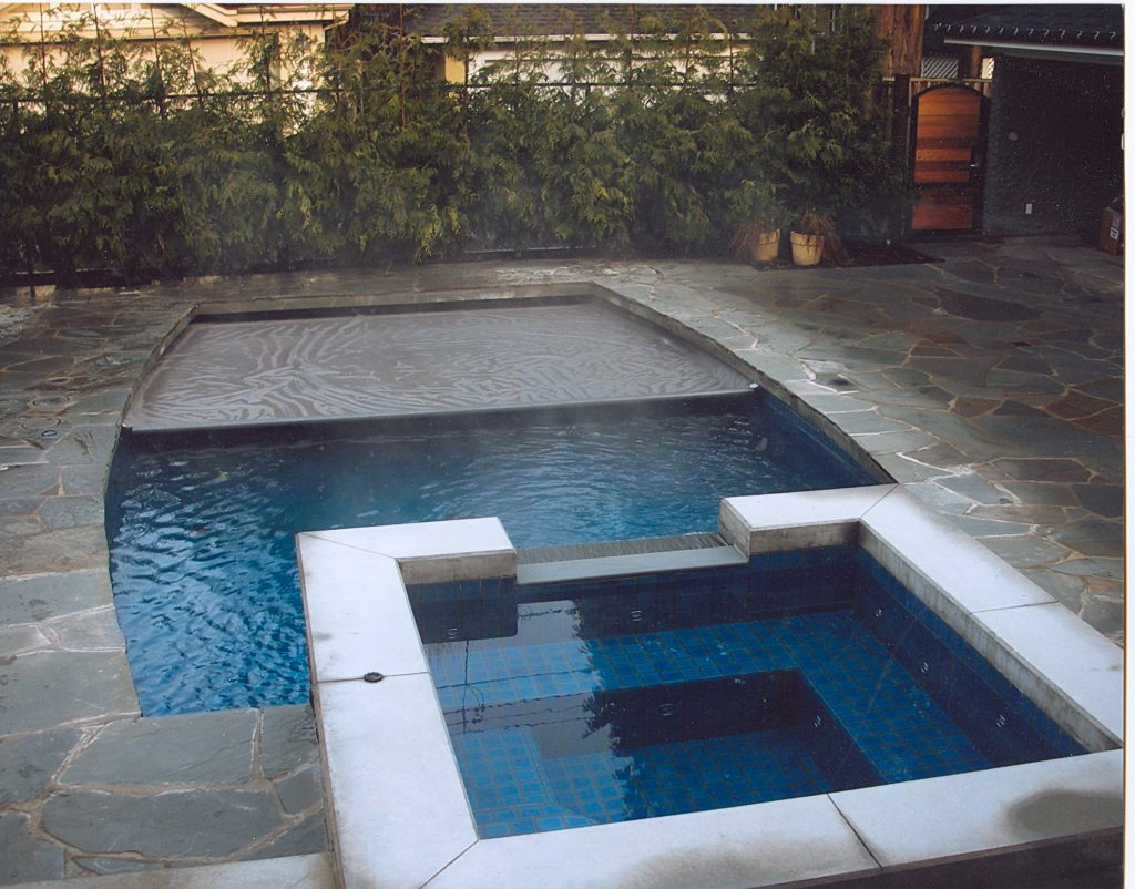 automatic pool cover - custom features to add to your swimming pool design - vancouver pool company - swimming pool contractor in vancouver - trasolini pools
