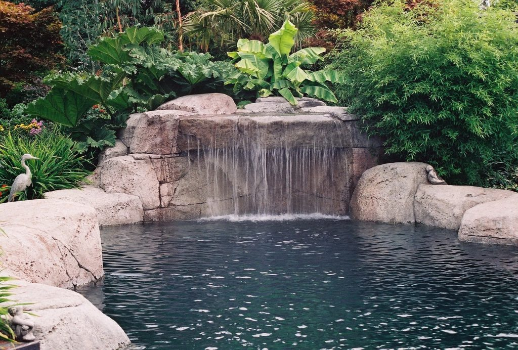 waterfall - custom features to add to your swimming pool design - vancouver pool company - swimming pool contractor in vancouver - trasolini pools